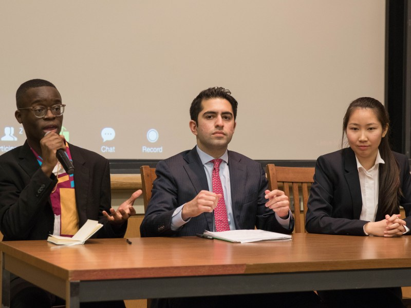 Student Assembly presidential candidates Cat Huang '21, Uche Chukwukere '21, and Dillon Anadkat debate in-person in March. After elections were postponed due to COVID-19, voting for the presidential race has been suspended, after last-minute concerns over the validity of the ballots arose Wednesday night.