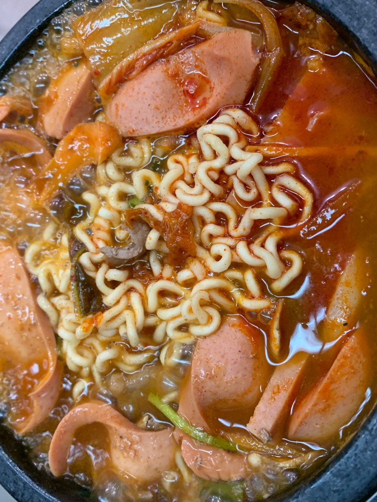 Budae jjigae, a sausage stew that comes with a variety of toppings such as ramen, rice cakes and kimch. (Grace Kim/Sun Contributor)