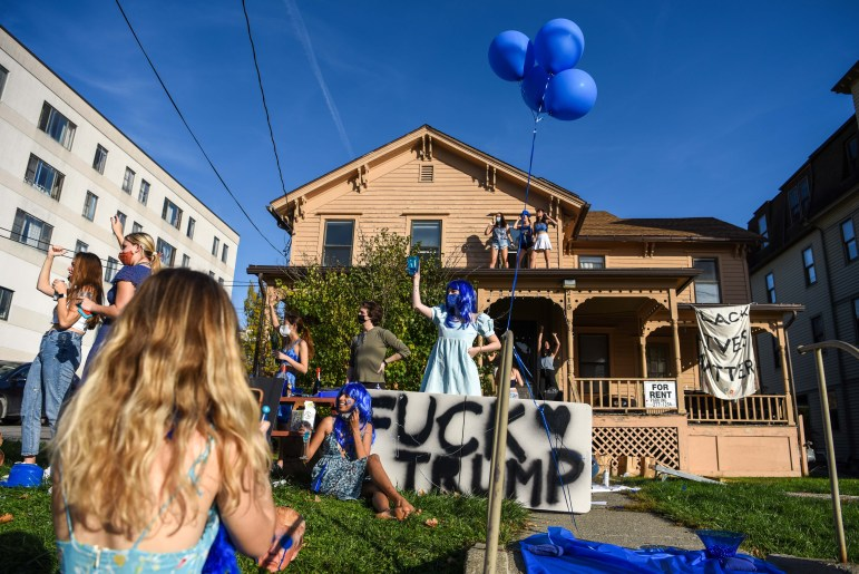 The Cornell campus cheered and exhaled a sigh of relief, as election week finally ended — taking to porches for celebrations.