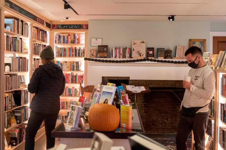 Customers browse through Odyssey Bookstore on Oct. 24.