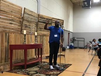 Pastor John Punni opening the service