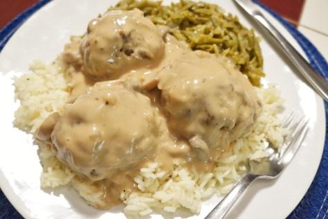 savory baked meatballs with brown mushroom gravy