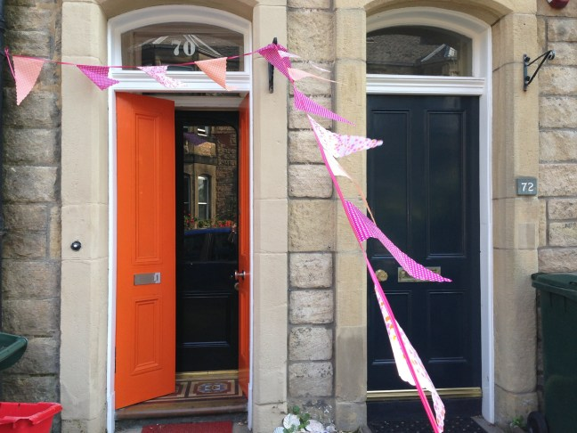 Bunting decorated door. Photo by Mary Hutchison