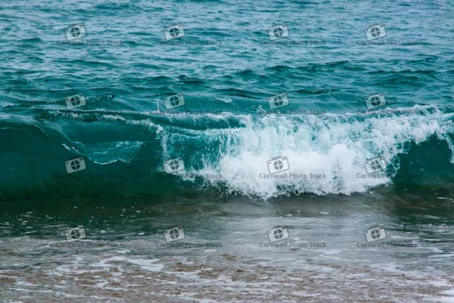 Wave Breaking on the beach shoreline in Cornwall