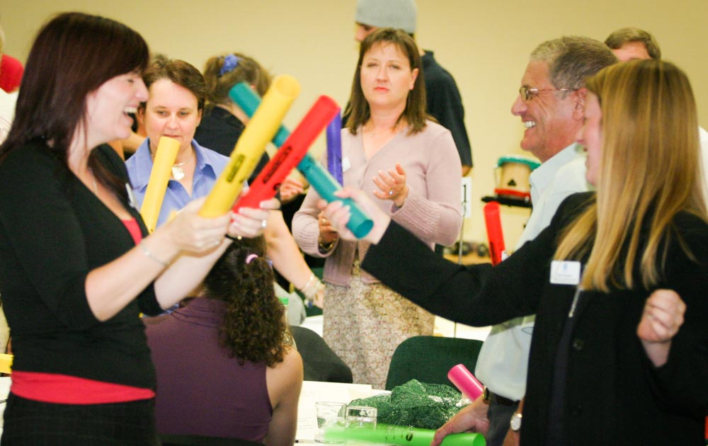 People enjoying playing boomwhackers team building activities