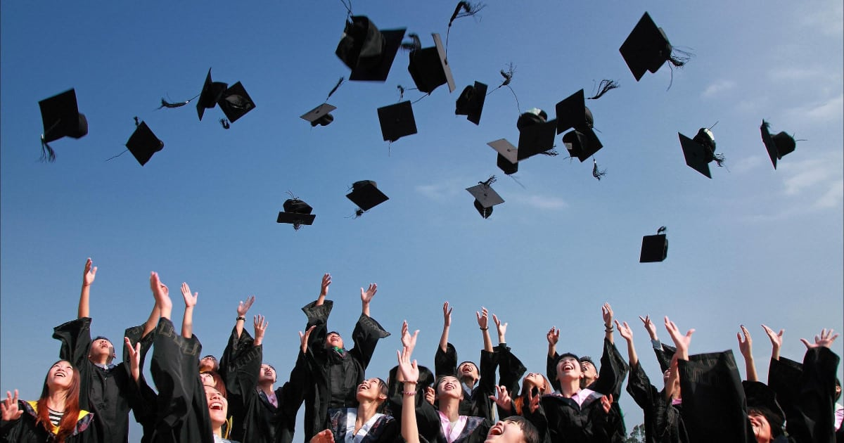 what to wear to law school graduation - image of women law students throwing caps in the air