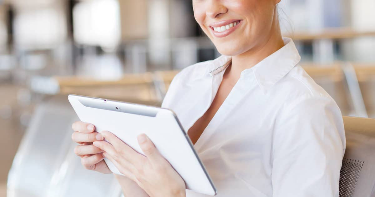 best solutions for gaping blouses - image of a businesswoman with an ipad in front of her gaping dress shirt