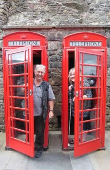 Ron Esplin and Julie Woods in phone boxes