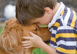 child with pet dog