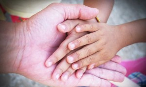 hands of grandchildren and grandparent