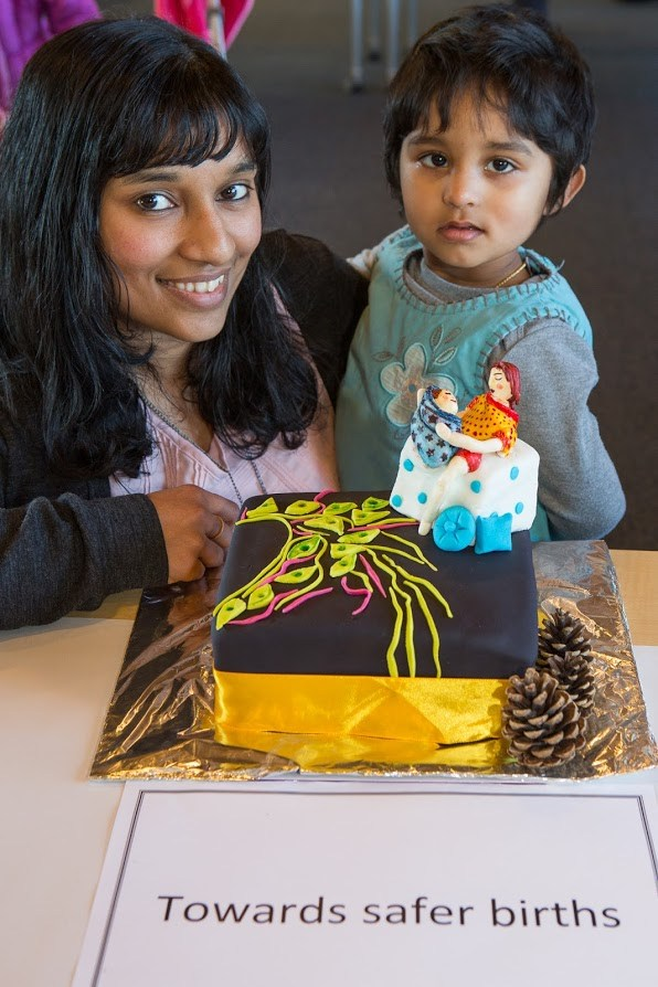 "Shalini Kumar and her daughter with her ""Bake your thesis"" cake."