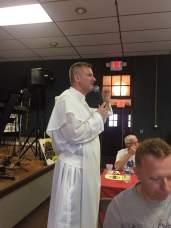 Fr. Michał Czyżewski, Pastor of Corpus Christi, says a prayer before contest.
