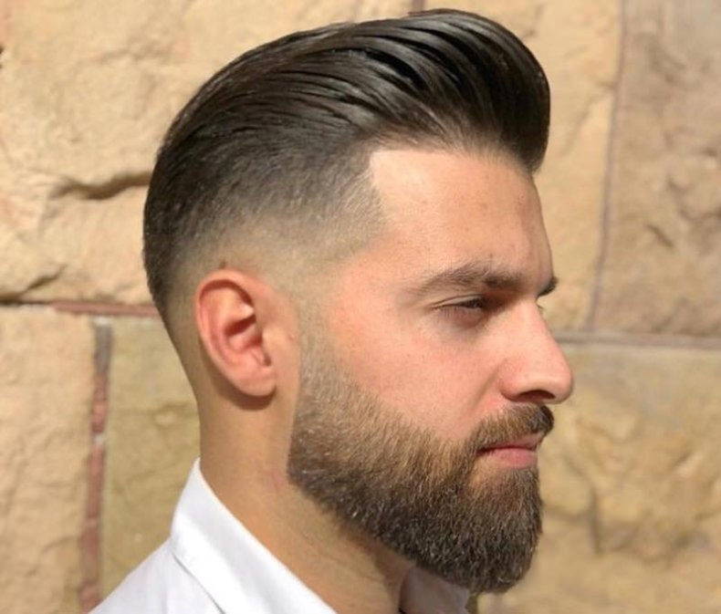 Men's hair cut shaved on the sides and shaded, worn backwards