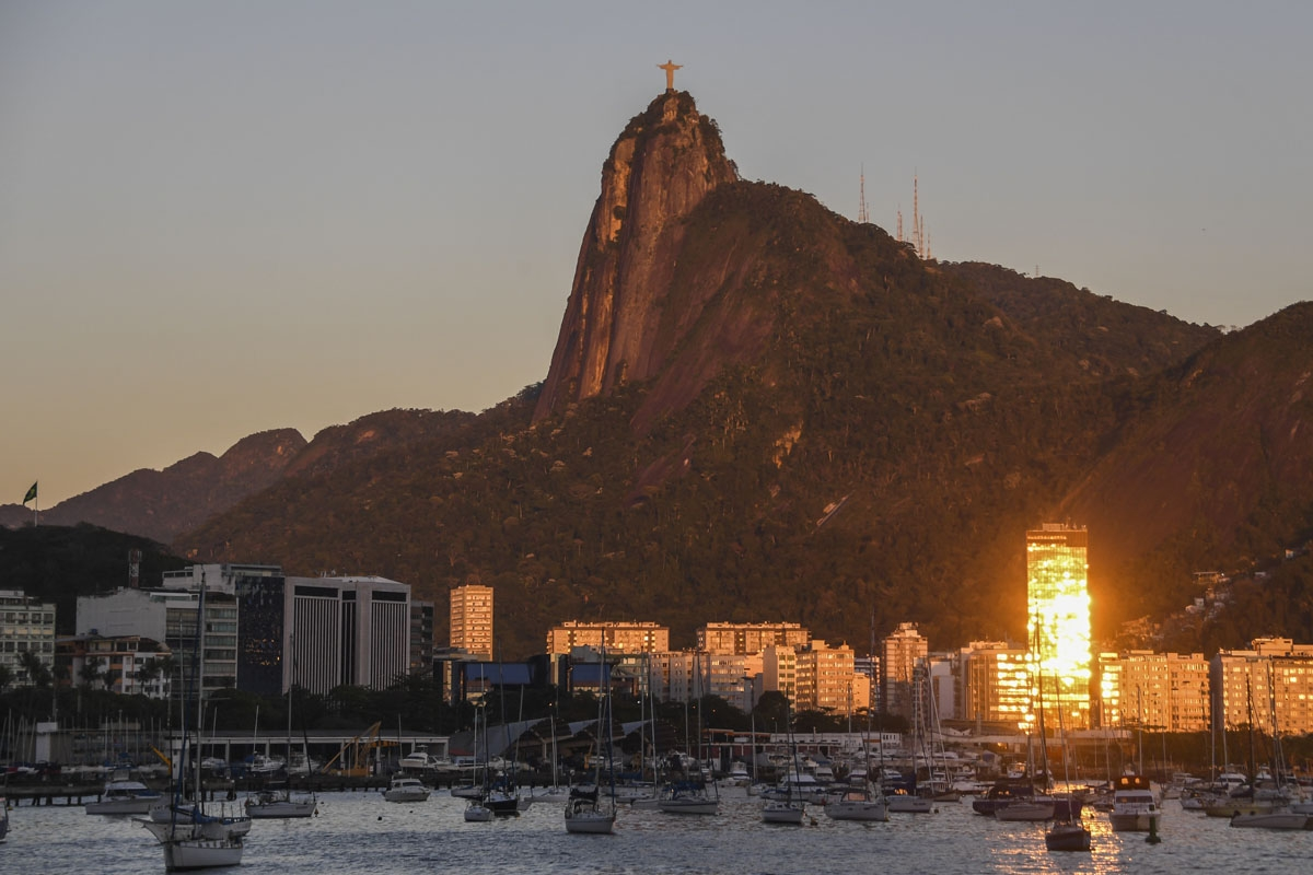 View of the Botafogo cove in the Guanabara Bay with Christ the Redeemer statue atop the Corcovado mountain, at dawn in Rio de Janeiro, Brazil, on September 4, 2017.