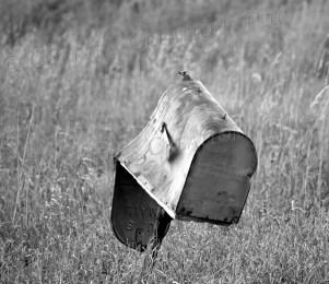 A mailbox that has definitely seen better days; photo taken in southeastern Nebraska
