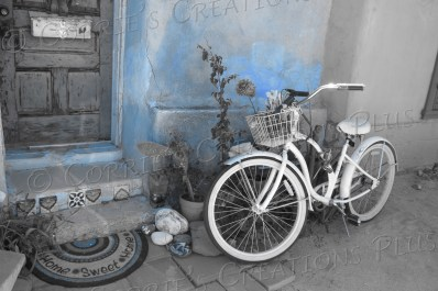 Blue one-point-color photo of a bicycle in downtown Tucson
