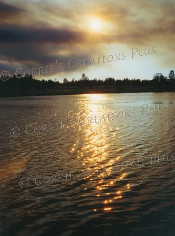 The sun sets behind smoke at the Lake of the Woods in Pinetop/Show Low, Arizona