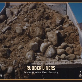 Rubber-Lined Haul Truck Dumping