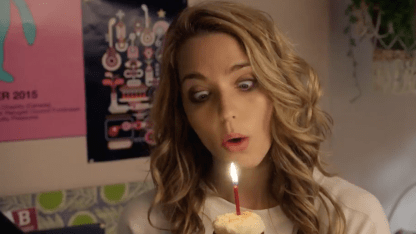 Our heroine blows out the candle on her birthday cake