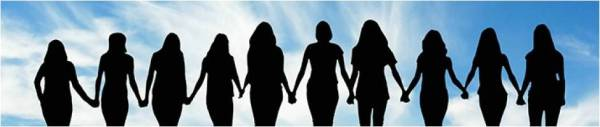 Silhouetted women holding hands