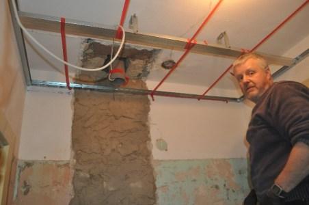 Martin surveys the render drying