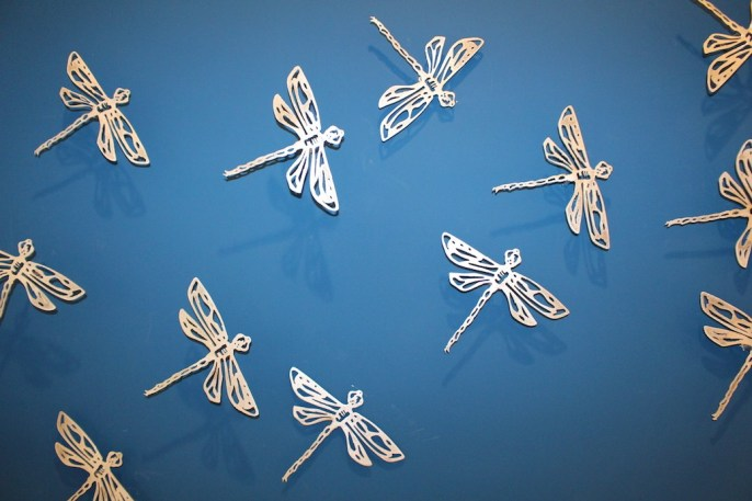 "Xavier Cortada, ""Dragonflies on Blue (detail),"" brushed aluminum cut-outs, 2014."