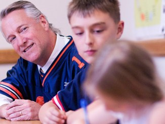 Parker Elementary School Principal Kevin Yard looks on as he works with Emerson Johnson, Helena Stevens and other members of the school's 5th Grade Recess Leadership Team during a meeting Tuesday. Yard plans to