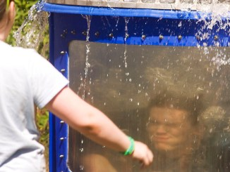 Bob Ellis/staff photographer Eammon Moneypenny-Hall gets dunked by Brooke Brown Saturday during the Dryden Lake Festival.