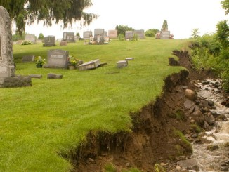 Running water caused the bank of a gully to collapse in June 2015 along the northern edge of St. Mary's Cemetery. Runoff from storms filled the northern side of the cemetery with rocks and debris.