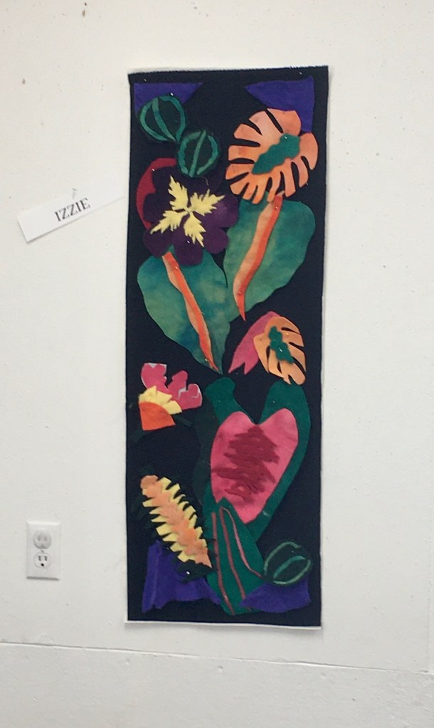 Quilt with appliqued leaves