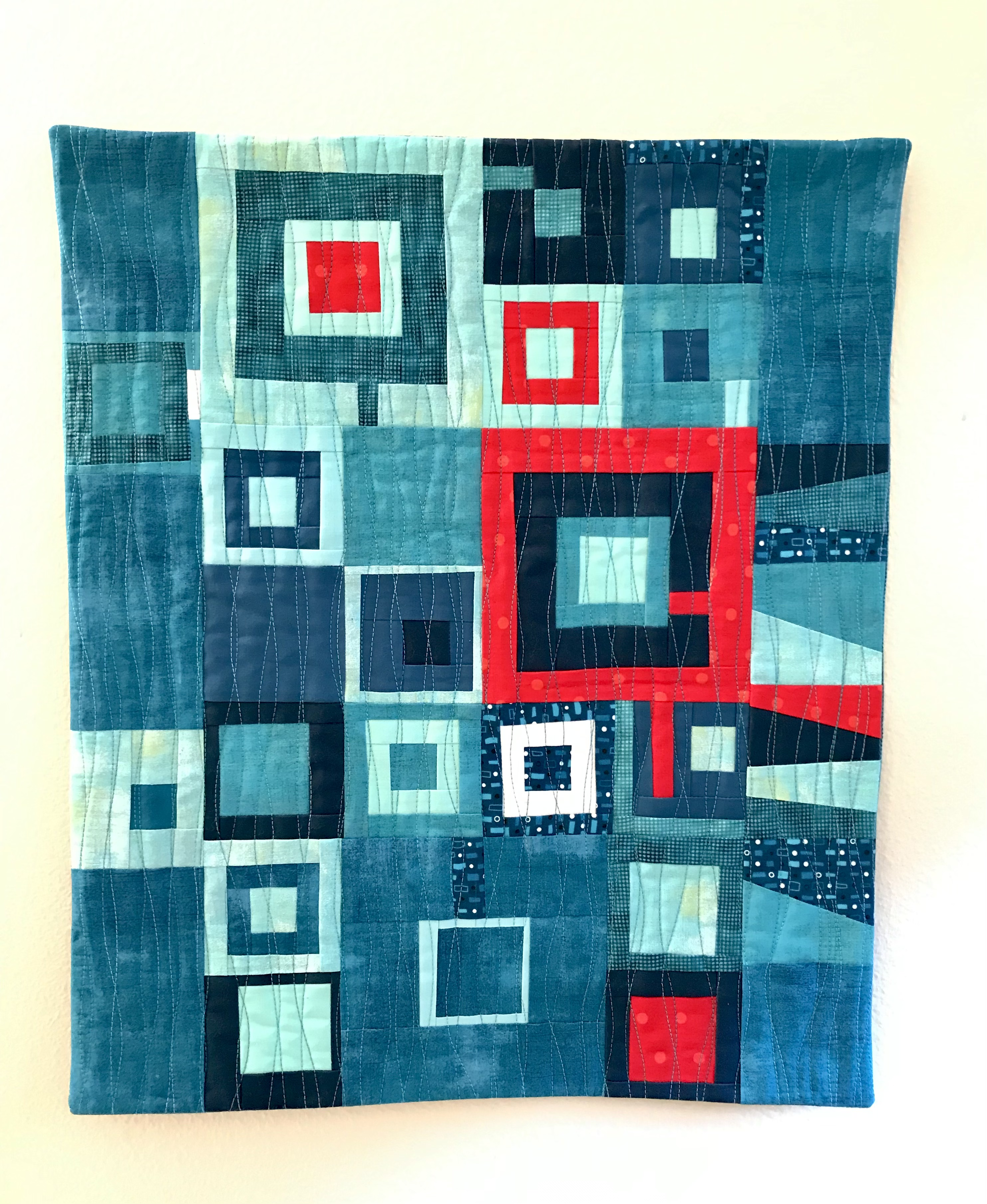 Turquoise with red accent squares