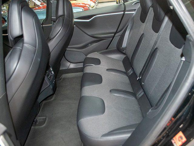 2017 black tesla s 75 back seat 1