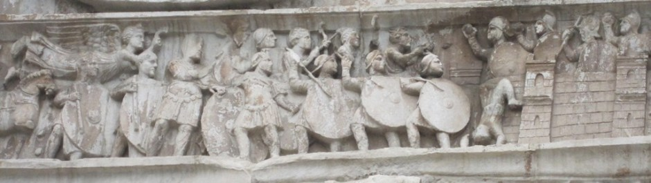 Detail from Constantine's Arch in Rome. Note the round shields of the soldiers.