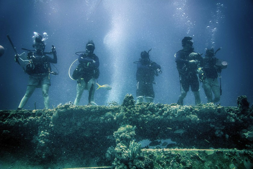 Members of Mission 31 stand atop Aquarius, the last remaining underwater research habitat.Photo courtesy of Francis Choi.