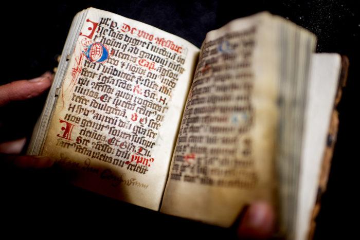 Dragon Prayer Book, Northeastern's medieval manuscript. Photo by Matthew Modoono/Northeastern University
