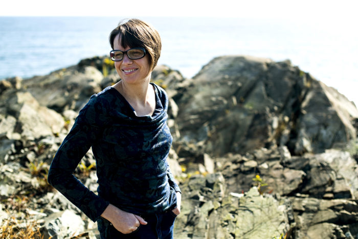 Katie Lotterhos, assistant professor in marine and environmental Sciences, poses for a portrait in Nahant. Lotterhos recently received a grant to work with a consortium of scientists across the East Coast to breed a better oyster. Photo by Ruby Wallau/Northeastern University