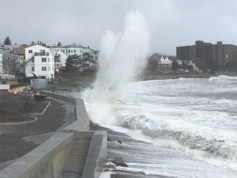 A wave hits a seawall in Winthrop, Massachusetts. Photo credit: Northeastern University/Carole McCauley