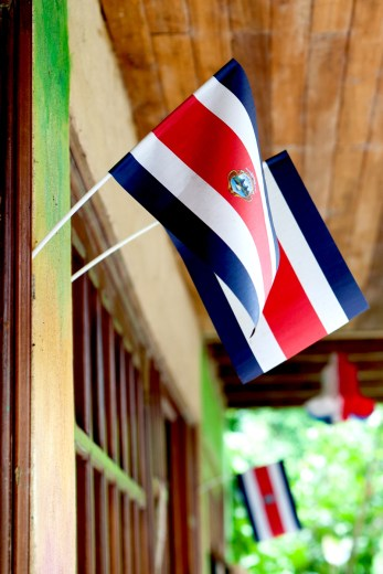 Flags of Costa Rica being hung at the farm.