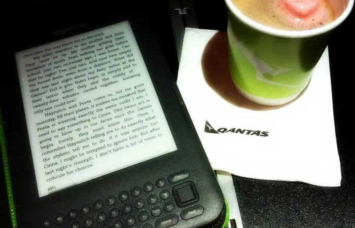 Reading Kindle books on an airplane.