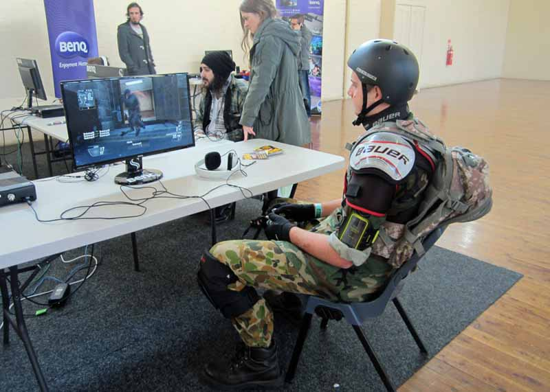 A guy in costume playing a video game.