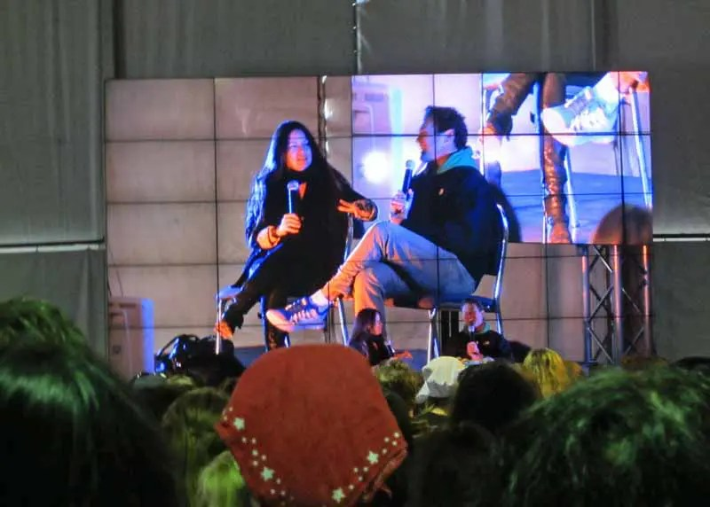Hollie Marie Combs and Brian Krause from Charmed on stage.