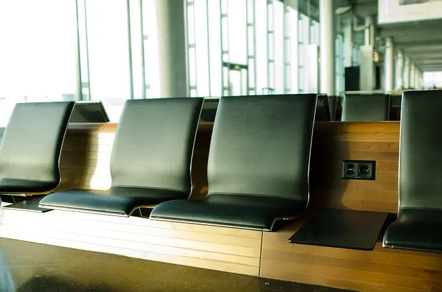 Empty seats at an airport terminal. Airport travel tips.