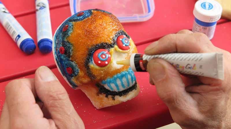 Decorating a sugar skull.