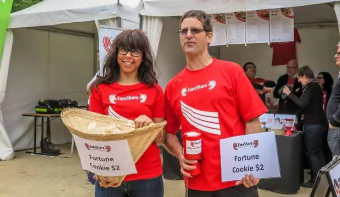 Two people collecting for charity.