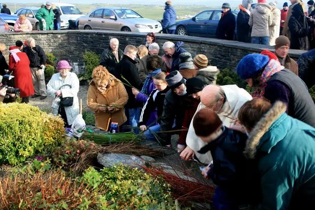 People making Brigid's crosses at St. Brigid's Well near Liscannor.