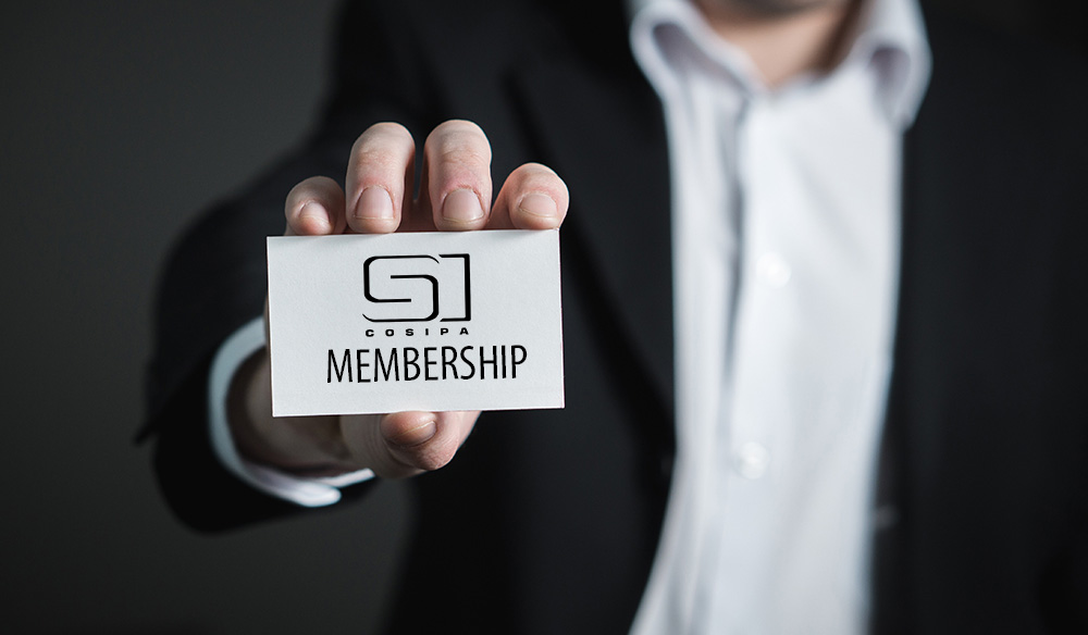 A man holding a card reading: COSIPA Membership