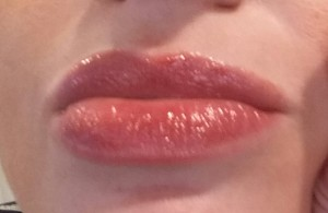 Honest Beauty Lip Gloss in Inspired Kiss - swatch