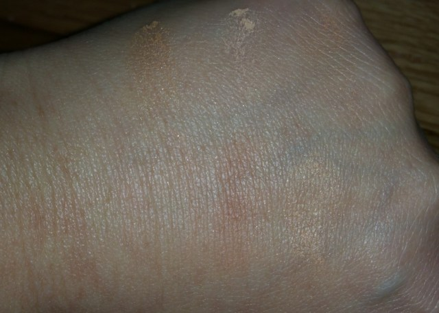 Bobbi Brown Nude Finish Illuminating Powder - Buff - colors swatched individually on hand - with flash