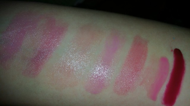 Swatched left to right: vBeaute Lip Spread- Distraction, Soap and Glory Sexy Mother Pucker - Punch Bowl Sangria, Fresh 21c Sugar Lip Treatment - Berry, Benefit Lollibalm, LOreal Nude Balm - Heavenly Berry 318 , Essence Sheer and Shine Lipstick - Sparkling Miracle -07, and Clinique Pop Glaze Sheer Lip Color + Primer - Bubblegum Pop 06