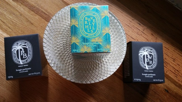 Left to right: Diptyque / Tomas Maier Palm Beach candle, Diptyque Beverly Hills candle, and Diptyque / Tomas Maier West District Road candle.